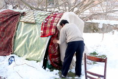 http://www.dreamstime.com/royalty-free-stock-photography-homeless-people-living-under-snow-image23224667